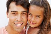 Portrait Of Hispanic Father And Daughter