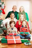 Happy family with seniors and children celebrating christmas