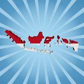 Indonesia map flag on blue sunburst illustration