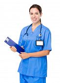 Female doctor with clipboard