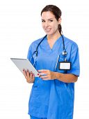 Brunette woman doctor use tablet