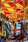 View Of Carousel With Horses On A Carnival Merry Go Round