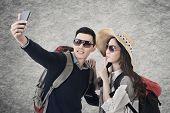 Asian couple travel and selfie, closeup portrait.