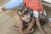 Adorable little girl while playing with her little brother