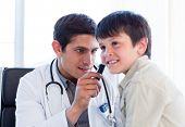 Serious Doctor Examining Little Boy's Ears