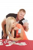 Man Behind Woman Playing Cards He Is Happy