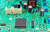 image of transistor  - green electrical circuit board with conductors and transistors