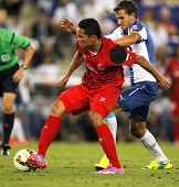 BARCELONA - AUG, 30: Carlos Bacca of Sevilla during spanish league match against Espanyol at the Estadi Cornella on August 30, 2014 in Barcelona, Spain