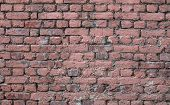Texture Of Old Wall Of Red Brick, Covered With Pink