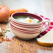 delicious plate of vegetable soup on a wooden table