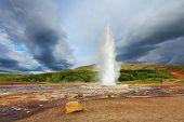 Famous geyser Strokkur in Iceland. Geyser erupts every few minutes