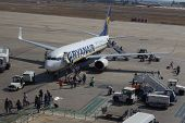 VALENCIA, SPAIN - SEPT 10, 2014: Passengers disembarking a Ryanair Boeing 737-800 aircraft at the Valencia airport.  In 2013, Ryanair was the largest European airline by scheduled passengers carried.