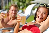 image of spring break  - People drinking beer at relaxing at beach resort having fun enjoying spring break - JPG
