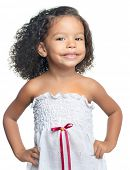 Portrait of a small afro american girl with curly hair isolated on white