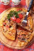 Tortilla, spanish omelet with mushrooms, potato and vegetables