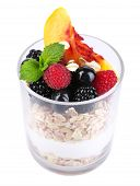 Healthy breakfast - yogurt with  fresh fruit, berries and muesli served in glass, isolated on white