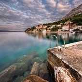 Stone Jetty In Small Village Near Omis At Dawn, Dalmatia, Croatia
