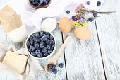 Fresh blueberries and milk products on wooden table