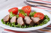 Duck Meat Fried With Tomato And Basil Close-up Horizontal
