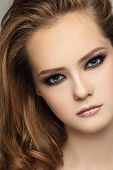 Close-up portrait of young beautiful teen girl with smoky eyes make-up