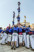 Castellers Do A Castell Or Human Tower, Typical  In Catalonia.