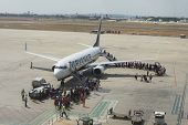 VALENCIA, SPAIN - SEPTEMBER 10, 2014: Passengers boarding a Ryanair Boeing 737-800 aircraft at the V