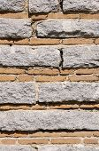 image of gneiss  - Old stone wall with bricks closeup in sunny day - JPG