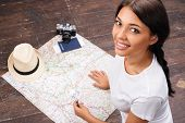 Yiung woman searching a map