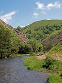 The River Dove At Dovedale In Derbyshire.