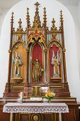 foto of sacred heart jesus  - Cuban Catholic Altar in a beautiful church displaying statues of angels and Jesus - JPG