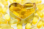 Fish Oil Pills On Heart Shape Box Isolated