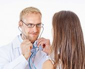 Doctor With Stethoscope And Glasses Examining Patient