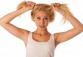 Beautiful Young Blonde Woman Holds Hair In Her Hand Gesturing Excitement Isolated Over White Backgro