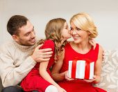 family, christmas, x-mas, happiness and people concept - adorable child kisses her mother and gives