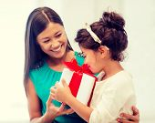 holidays, presents, christmas, x-mas and birthday concept - happy mother and child girl with gift bo