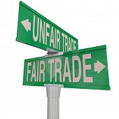 Fair Vs Unfair Trade words on two way street signs pointing you to choose businesses who offer livin