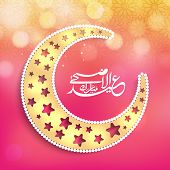 Beautiful golden moon decorated with star shape engraving and arabic islamic calligraphy of text Eid