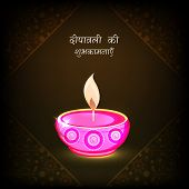 Beautiful illuminated oil lit lamp on floral design decorated brown background with wishes in Hindi