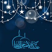 Beautiful decoration with shiny silver stars and moon on occasion of Muslim community festival Eid-Ul-Adha celebrations.