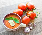 Bowl of tomato soup gaspacho with basil and crackers
