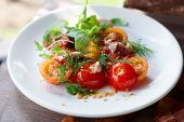 Simple appetizer with cherry tomatoes and duck meat