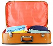 Female clothes in old suitcase, isolated on white