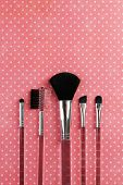 Brushes for makeup on pink background