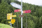 FERRET, SWITZERLAND - AUGUST 30: Tour du Mont Blanc direction signs. The popular tour goes through F
