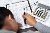 Woman Stress With Tax Form