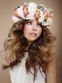 Aroma. Genuine Brunette In Wreath Of Flowers Looking Up