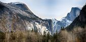 picture of granite dome  - Half Dome and North Dome as seen from the Merced River below - JPG