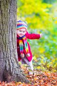 Little Girl Having Fun In An Autumn Park