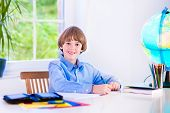 Smiling Boy Doing Homework