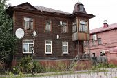 Old Wooden House With Television Antennas